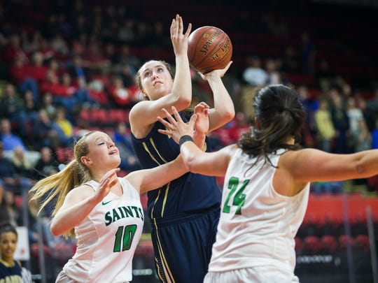 Susquehanna Valley's Maeve Donnelly shoots over Seton Catholic Central's Ava McCann, left, and Marina Maerkl during the fourth quarter of Friday's Section 4 Class B girls basketball final at Floyd L. Maines Veterans Memorial Arena.