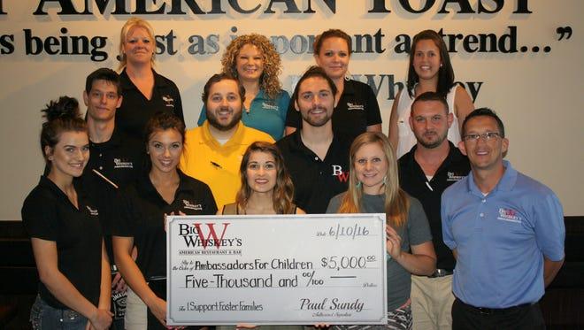 Big Whiskey's Restaurant and Bar raises $5,000 for Ambassadors for Children
