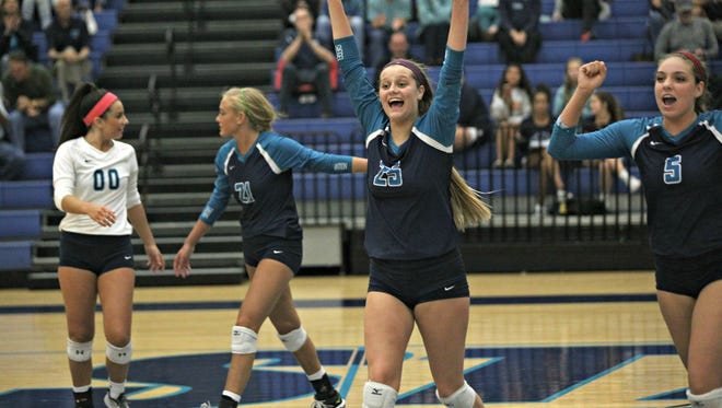 Siegel's (l-r) Julia Poarch, Leah Poarch, Sophia Bossong and Hannah Adams celebrate a point during last week's sectional win over Cookeville.