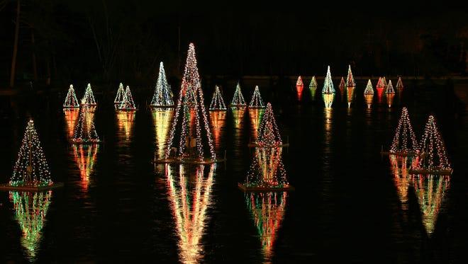 Historic Smithville Village's lake is illuminated by 50,000 Christmas lights.