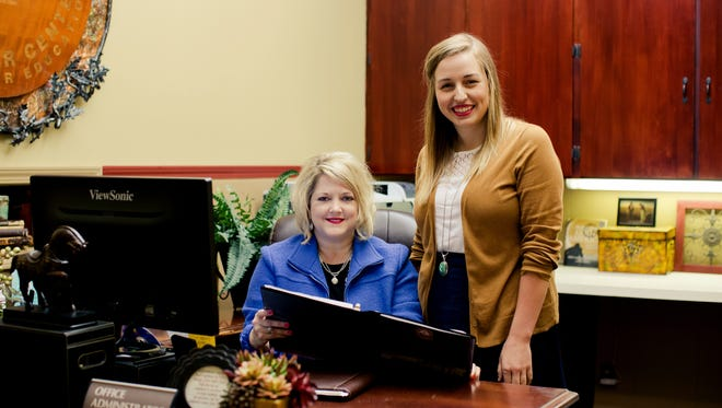 : Pamela Spears, administrative assistant and event planner for The Keeter Center for Character Education, works with senior Lauren Scott on projects for the spring 2017 semester at College of the Ozarks. The College has been recognized once again as one of the Great Colleges to Work For by The Chronicle of Higher Education.