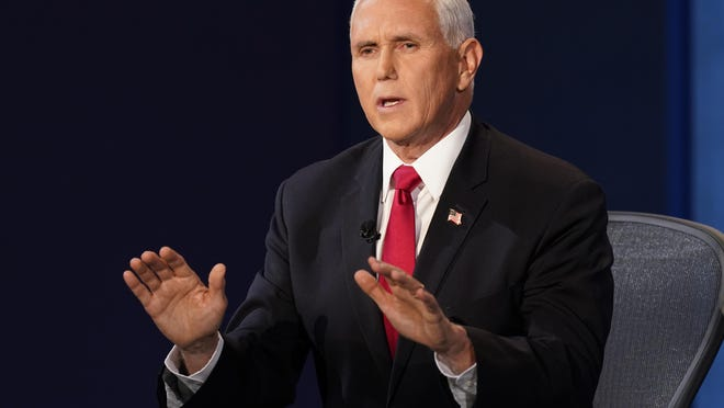 Vice President Mike Pence makes a point during the vice presidential debate with Democratic vice presidential candidate Sen. Kamala Harris, D-Calif., Wednesday, Oct. 7, 2020, at Kingsbury Hall on the campus of the University of Utah in Salt Lake City.