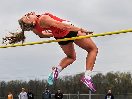 Pleasant's Kamryn Kimmel goes over the bar in the high jump during Tuesday's Marion County Track Meet at Pleasant. Kimmel qualified for the regional in four events, including the high jump.