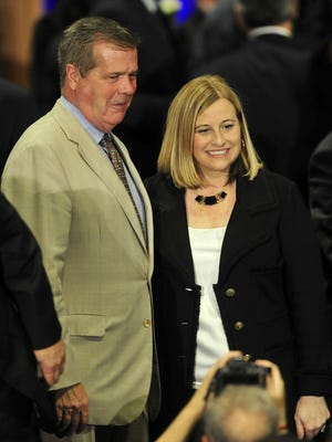Mayor Megan Barry, right, takes a picture with former mayor Karl Dean during her inaugural ceremony at Music City Center Sept. 25, 2015.