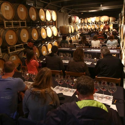 Willamette Valley Vineyards winery ambassador Veronica Ball takes a group on a tour of the winery on Friday, Nov. 27, 2015.