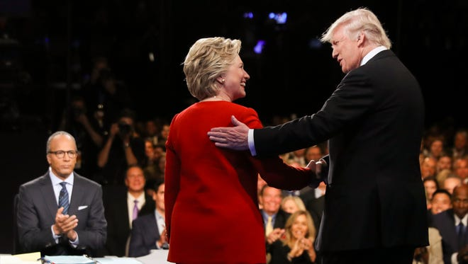 Hillary Clinton and Donald Trump shake hands during the presidential debate at Hofstra University in Hempstead, N.Y., on Sept. 26, 2016.