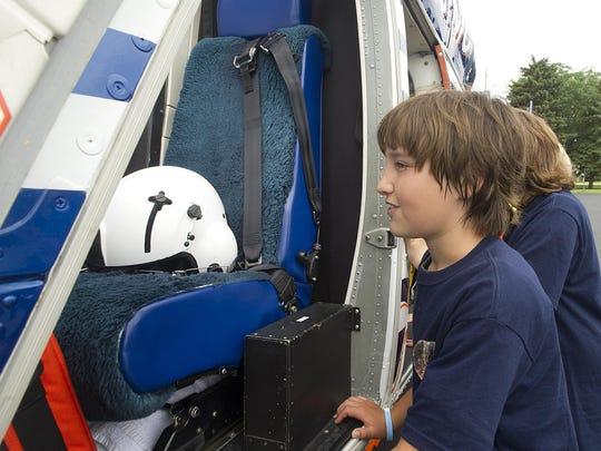 Oakfield Junior Police Academy member Jack Wischnefski looks into the Flight for Life helicopter. The helicopter made a stop at the Oakfield High School on Thursday, June 25, as part of the three-week Junior Police Academy class.