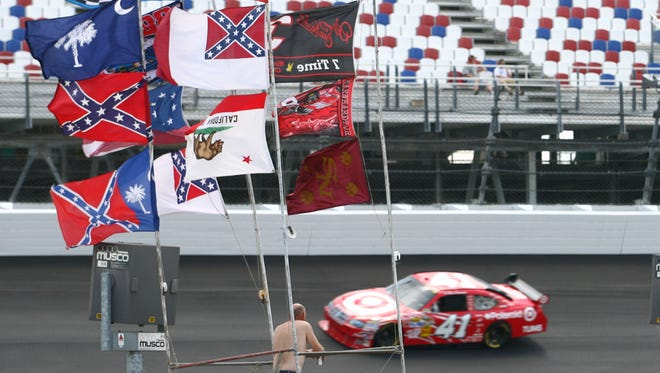 Confederate and other flags fly at Darlington Raceway  during practice for a 2008 NASCAR race.