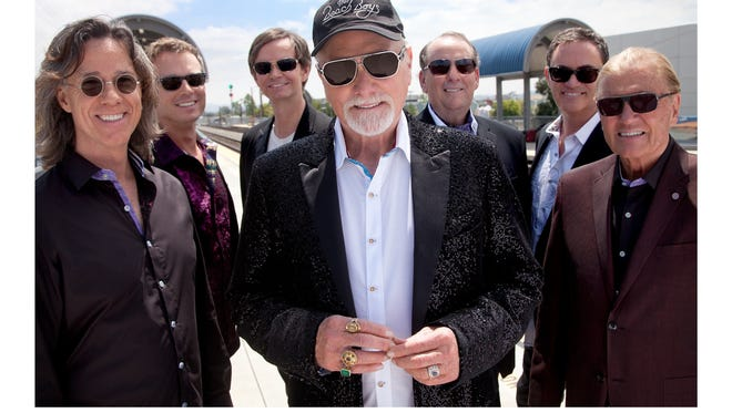 "Mike Love, center, with the current Beach Boys lineup. ""We like performing,"" he says. ""It's not like somebody's putting a gun to our heads."""