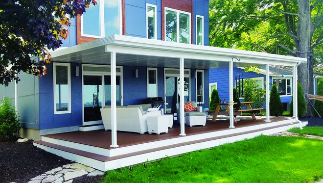This aluminum framework, manufactured by Craft-Bilt, and installed on the back of this home as a cover for an outdoor space, may be the first phase of what might ultimately become an enclosed porch or sunroom.