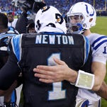 Indianapolis Colts quarterback Andrew Luck (12) meets with Carolina Panthers quarterback Cam Newton (1) after the team's loss of an NFL football game Monday, Nov. 2, 2015, at Bank of America Stadium in Charlotte, North Carolina. Panthers won in sudden-death overtime 29-26.