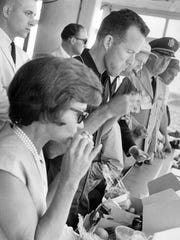 The Coopers,  Gordon and Trudy, chow down on fried chicken during the 1963 Indy 500.