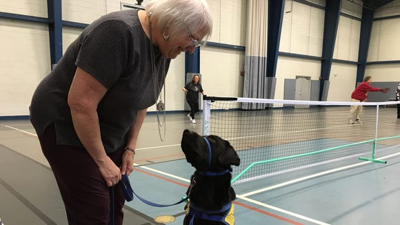Debra Everington and CCI pup Chance at a recent pickleball practice session.