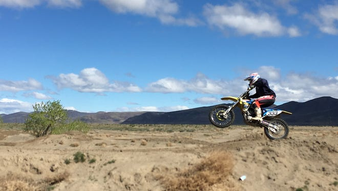 A racer takes a practice lap at  the Fernley/Wadsworth Lions Club International Raceway in advance of the Old Timers International Moto-X which was held April 16-17.