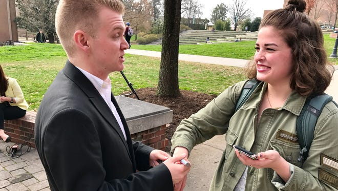 Turner Matthews, left, draws an X on the hand of fellow student AC Herline to mark Shine a Light on Slavery Day on Thursday, Feb. 23, 2017, at the University of Tennessee.