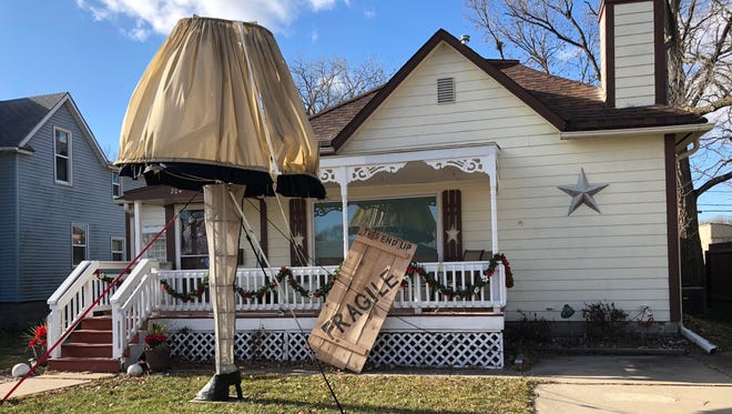 "Tom Gross, 60, created a leg lamp from the Christmas classic ""A Christmas Story"" as a lawn decoration in front of his home on the 200 block of 8th Street in West Des Moines."