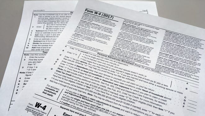 An IRS W-4 form on Thursday, Feb. 1, 2018, in New York. Workers are starting to see more take-home pay as employers implement the new withholding guidelines from the IRS.