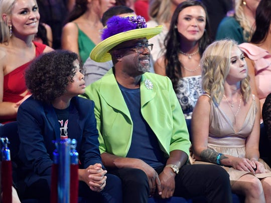 Darius Rucker is colorfully dressed in the audience at the 2018 CMT Awards Wednesday, June 6, 2018, at Bridgestone Arena in Nashville, Tenn. Behind him, at left, is Lindsey Vonn.