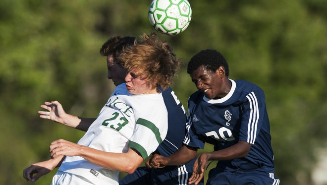 Rice's Hayden Kjelleran (23) and Burlington's Julian Segar-Reed (20) battle to head the ball during a high school boys soccer game Tuesday.