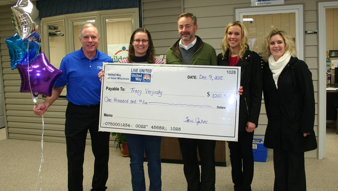 Tracy Verjinsky of Childcaring, Inc. (second from left) won one of the $1,000 cash prizes. Pictured here is our 2015 Campaign Chair John Culhane, Tracy Verjinsky, River Cities Bank President Fred Siemers, River Cities Bank Marketing Coordinator Briel Kohl and United Way of Inner Wisconsin CEO Tari Jahns.