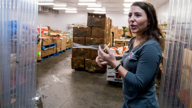 Anastasia Papastefan, Program Nutrition Specialist, shows off the cooler room in the Market Spot at the Montgomery Area Food Bank that is used for the FORK program along with other programs at the facility in Montgomery, Ala. on Friday December 1, 2017.