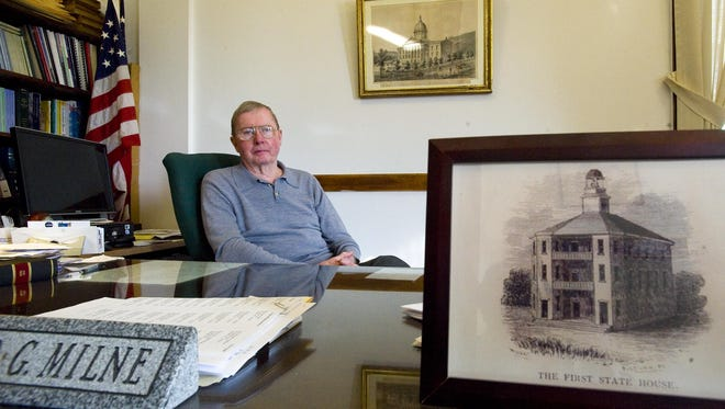 Clerk of the Vermont House of Representatives Don Milne at his desk at the Statehouse in Montpelier in December 2010.