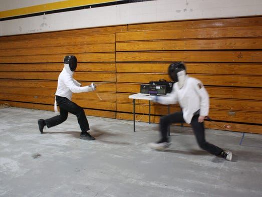 Students have fun learn discipline through fencing club