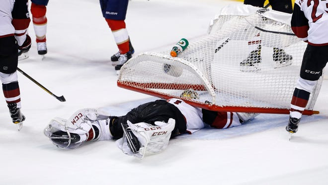 Mar 23, 2017; Sunrise, FL, USA; The net falls on  Arizona Coyotes goalie Mike Smith (41) after a goal by Florida Panthers left wing Shawn Thornton (not pictured) in the second period at BB&T Center.
