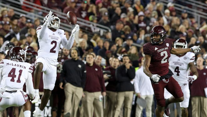 Mississippi State Bulldogs defensive back Jamal Peters (2) tips a pass intended for Texas A&M Aggies wide receiver Jhamon Ausbon (2).