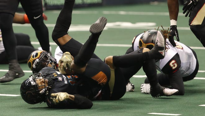 The Barnstormers' Jeremy Gloston (6) tackles the Rattlers' Dezmon Epps (17) after a catch during a Rattlers game at Talking Stick Resort Arena in Phoenix, Ariz. on May 20, 2018.
