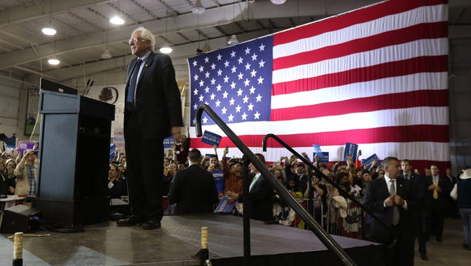 Bernie Sanders takes in the crowd at a presidential campaign event in New York last year. Sanders criticized Democratic senators who voted against legislation to allow drugs to be imported from Canada and other countries.