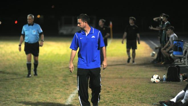 Washington boys soccer head coach Felipe Lawall walks the sideline during the Wildcats' 1-1 Senior Night draw with Catholic on Tuesday.