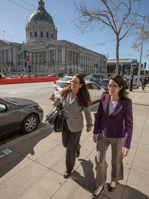 Ellen Pao, right, a former venture capitalist at Kleiner Perkins Caufield and Byers, leaves the San Francisco Civic Center Courthouse with attorney Therese Lawless in San Francisco on Tuesday.