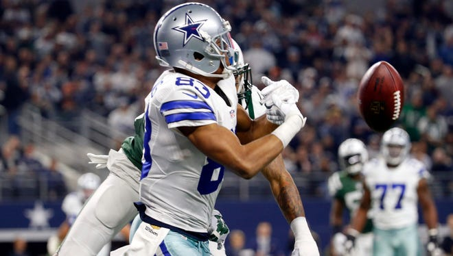Dallas Cowboys wide receiver Terrance Williams (83) cannot make a catch as New York Jets defensive back Buster Skrine (41) defends during the first quarter at AT&T Stadium.