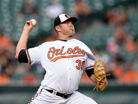 Baltimore Orioles starting pitcher Chris Tillman throws during the first inning of a baseball game against the Colorado Rockies, Tuesday, July 26, 2016, in Baltimore. (AP Photo/Nick Wass)