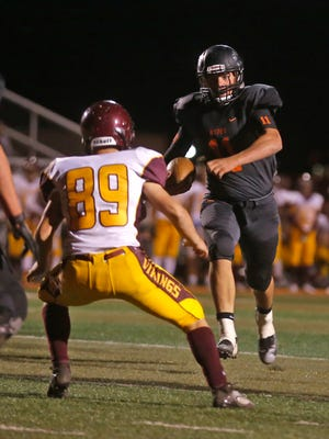 Aztec quarterback Cody Smith carries the ball toward the end zone during Friday's game against Valley at Fred Cook Memorial Stadium in Aztec.