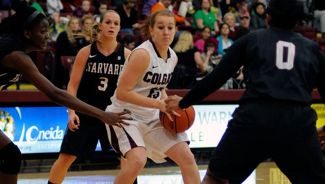 Katie (13) and Ali (3) Curtis, shown here in last year's match up between Harvard and Colgate, open their respective schools' basketball season.