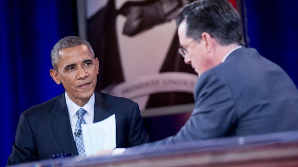 """President Obama and Stephen Colbert during a taping of Comedy Central's """"The Colbert Report"""" in Lisner Auditorium at George Washington University on Dec. 8."""