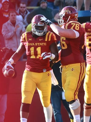 Iowa State's EJ Bibbs (11) celebrates with teammate Jamison Lalk on Saturday at Jack Trice Stadium. Bibbs caught five passes for 43 yards and a touchdown in a 34-31 defeat.