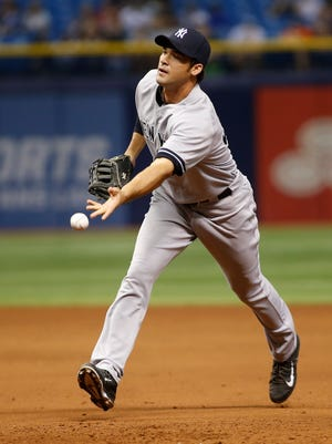Garrett Jones, making a rare start, went 3 for 4 with a triple Sunday in the Yankees' 5-3 win over the Rays.