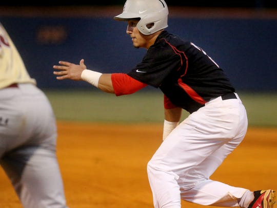 Stewarts Creek's Tre Bailliez leads off base during