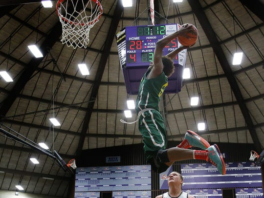 Crispus Attucks' Jamal Harris (5) soars for a dunk