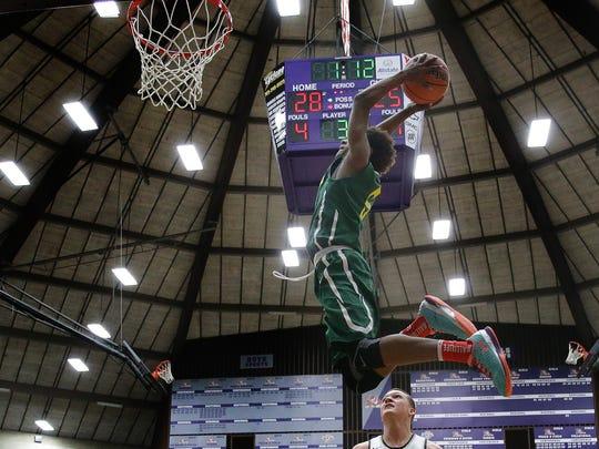 Crispus Attucks' Jamal Harris (5) soars for a dunk
