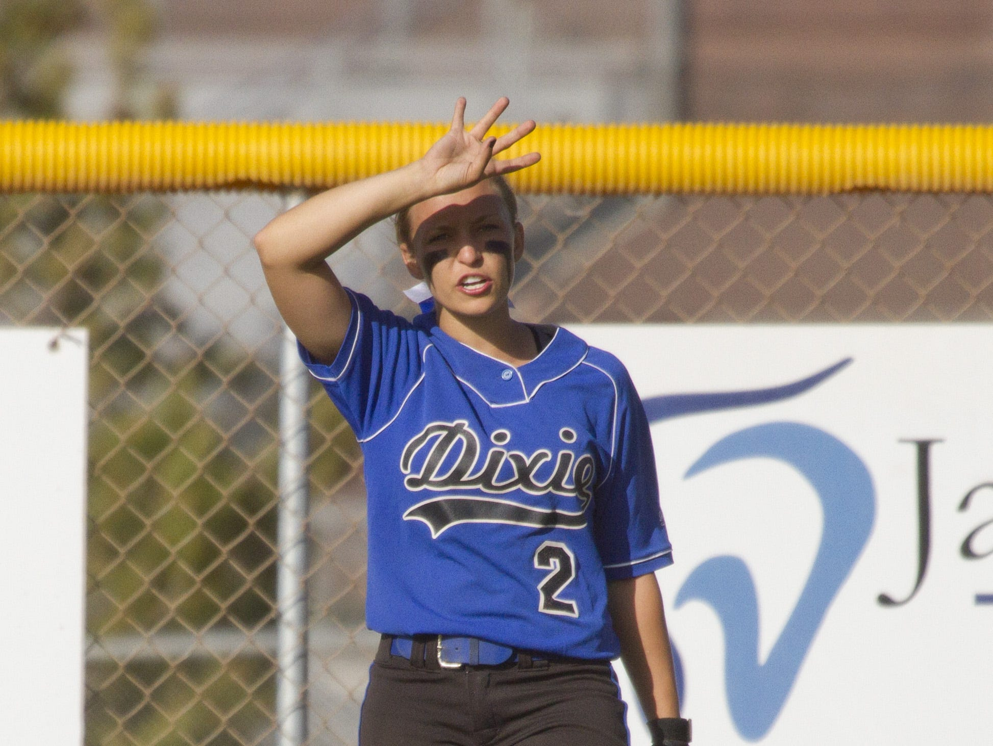 Dixie outfielder Shaunna Gelter signals to teammates during a game against Desert Hills on Tuesday.