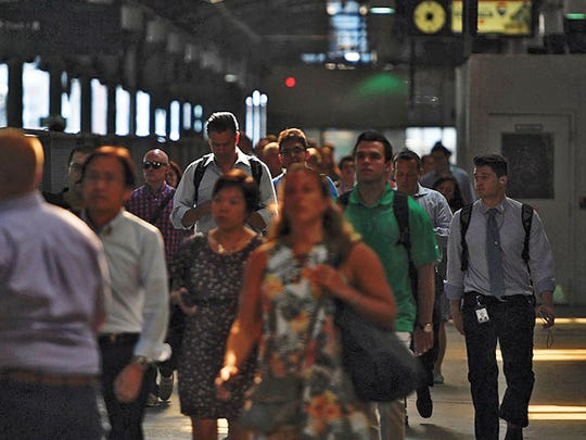"Commuters pass through Hoboken Terminal during the evening rush hour to end the first day of the ""Summer of Hell"" on Monday, July 10, 2017 (Danielle Parhizkaran/@danielleparhiz)."
