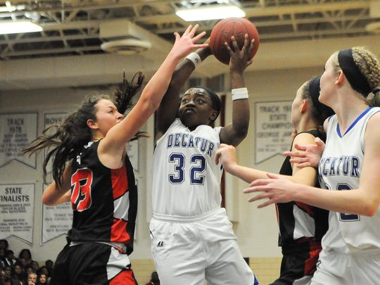 Stephen Decatur's Dayona Godwin drives to the basket against Glenelg High School during Saturday's 3A East Regional Championships in Berlin, Md. Megan Raymond Photo