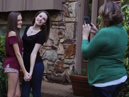 Brittan Gilmore, center, who was conceived with an