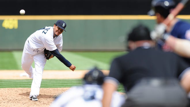 Seattle Mariners starting pitcher Felix Hernandez (34) pitches to Cleveland Indians second baseman Jason Kipnis (22) during the sixth inning at Safeco Field.