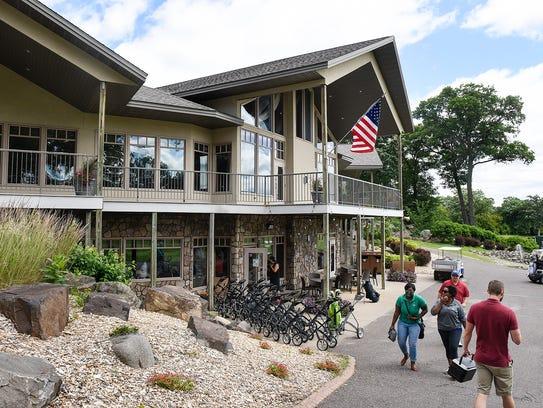 People walk toward the Blackberry Ridge Golf Course