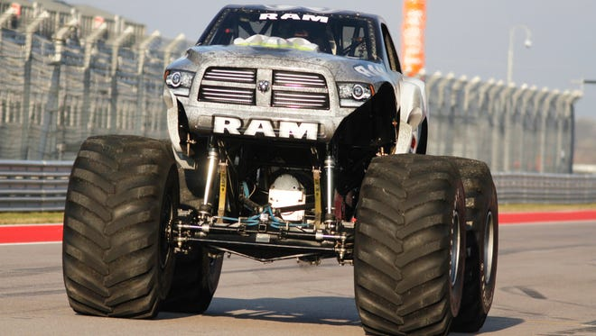 Mark Hall reaches a speed of 99.1 mph in Raminator, based on Chrysler Group's Ram pickup, to set Guinness World Record for fastest monster truck Dec. 15, 2014.